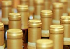 Wine Bottles. Abstract shot of cork side of sealed white wine bottles Royalty Free Stock Photo
