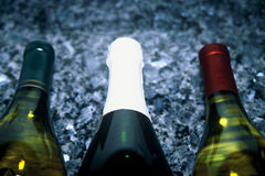 Wine Bottles. Three wine bottles showing the upper half of the bottles Royalty Free Stock Photo
