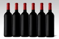 Wine bottles. Six Wine bottles on a white background Stock Photography