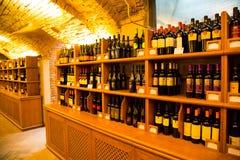 Wine bottles in authentic Italian wine cellar Stock Photo