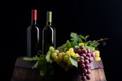 Wine bottles on a barrel. With wine accessories stock images