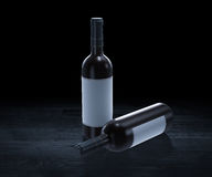 Wine bottles. In black background Stock Photos
