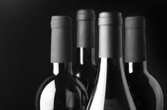 Wine bottles on black background Stock Image