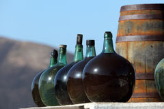 Wine bottles in a bodega, Lanzarote Royalty Free Stock Image