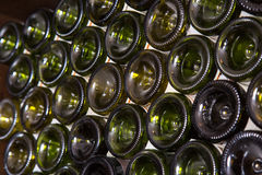 Wine bottles in a cellar Royalty Free Stock Photo