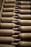 Wine Bottles in Cellar Stock Photos