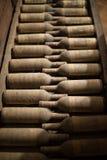 Wine Bottles in Cellar Stock Photography