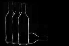 Wine Bottles. Close up Low-key Studio Shot of Four Wine Bottles on a Black Background.Copy Space Royalty Free Stock Photography