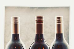 Wine bottles close up in wine store royalty free stock photography