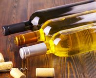 Wine bottles collection on wooden background. Wine bottles collection on wooden background Stock Photo