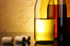 Wine bottles and corks Stock Images