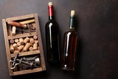 Wine bottles, corkscrew and corks Stock Images