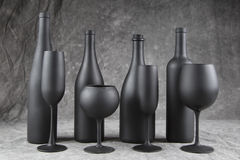 4 wine bottles with corresponding stemware. 4 Bottles and Flutes painted in flat black on a mottled grey background royalty free stock images