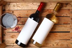 Wine bottles in a crate Royalty Free Stock Photos
