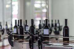 Wine bottles factory line stock images