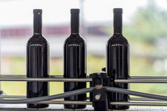 Wine bottles factory line royalty free stock images