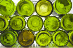 Wine bottles in front of light background. Wine bottles with light background on reflecting surface Stock Photos