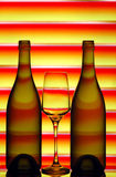 Wine bottles and glass Stock Image