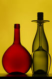Wine bottles and glass Stock Images