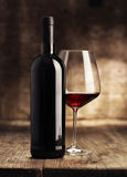 Wine bottles with glass Stock Photo