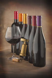 Wine bottles, glass and corkscrew Stock Photography