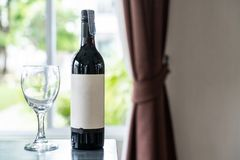 Wine bottles and glasses of wine on table stock image