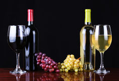 Wine Bottles and Glasses of Wine over black. Background stock photography