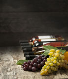 Wine bottles and grape Royalty Free Stock Image