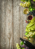 Wine bottles with grapes and corks on wooden background Stock Photo