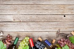 Wine bottles and grapes Royalty Free Stock Photography