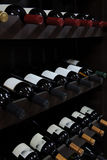 Wine bottles in a liquor store Stock Photos
