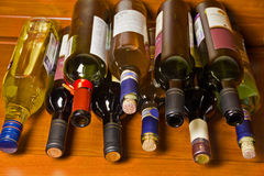 Wine bottles lying. On the shelves royalty free stock photos