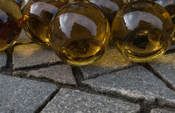 Wine bottles lying on the pavement Stock Image