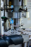 Wine bottles on the machine in production Stock Images
