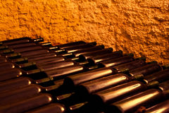 Wine Bottles in an Old Wine Cellar Stock Photos