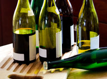 Wine bottles after the party. A group of wine bottles partially filled and some empty. whats left after the party Stock Photos