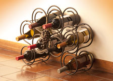 Wine bottles in rack. Red and white wine bottles stacked on iron rack shot with limited depth of field Royalty Free Stock Photo
