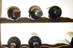 Wine bottles in rack Royalty Free Stock Images