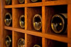 Wine Bottles rack. Wooden wine rack in the french restaurant Stock Images