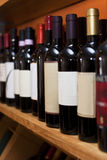 Wine bottles in a row Royalty Free Stock Photography