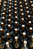 Wine bottles in a row as a pattern with cork Royalty Free Stock Photography