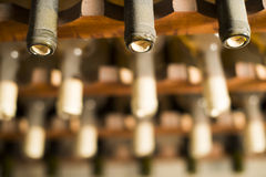Wine bottles on shelf Stock Image