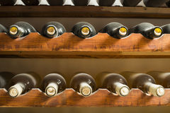 Wine bottles on shelf Stock Images