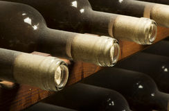 Wine bottles on shelf Royalty Free Stock Photography