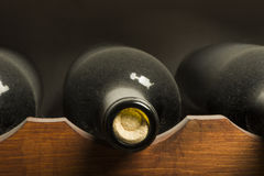Wine bottles on shelf Royalty Free Stock Images