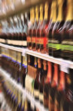 Wine bottles on shelf in a store Stock Image