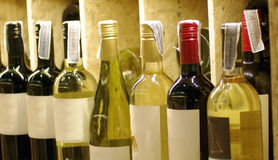Wine bottles on shelf Royalty Free Stock Images