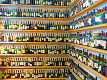 Wine bottles on shelves Royalty Free Stock Photos