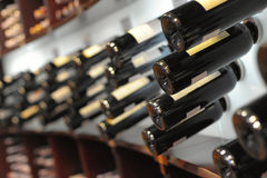 Wine bottles in shop Royalty Free Stock Images