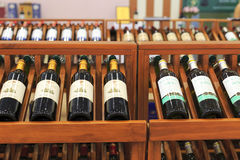Wine in bottles in shop Royalty Free Stock Image